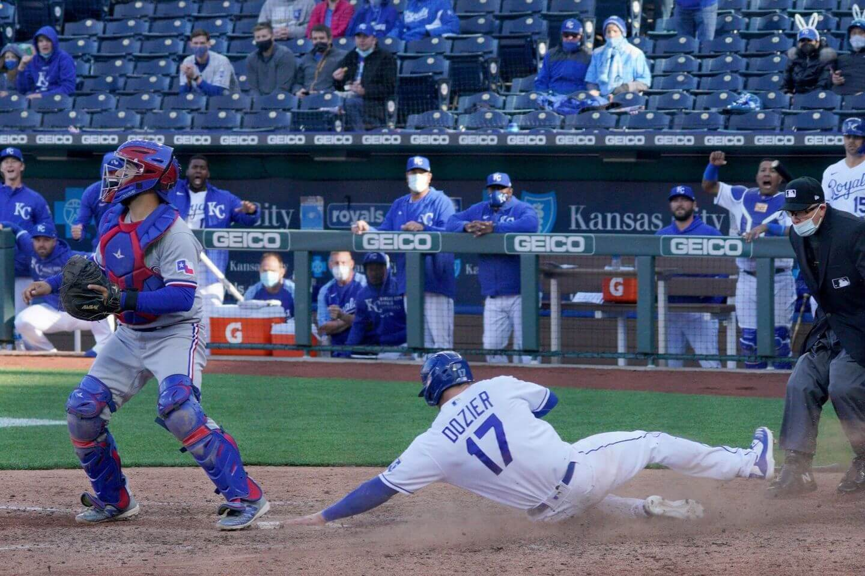 Royals and Rangers combine for 24 runs in opener