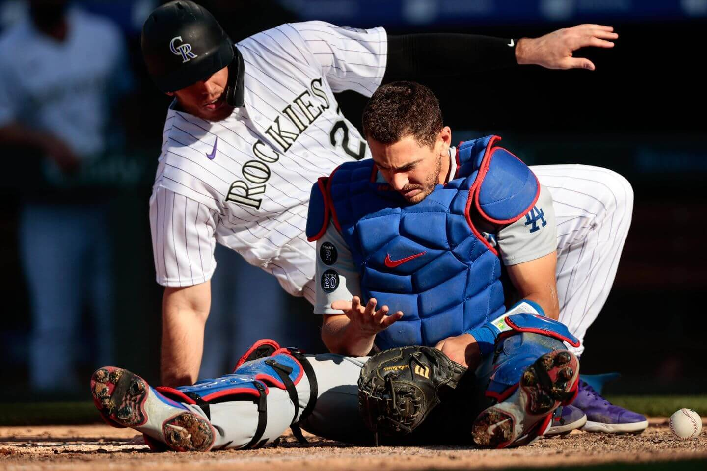 Defending champion Dodgers drop slugfest to the Rockies